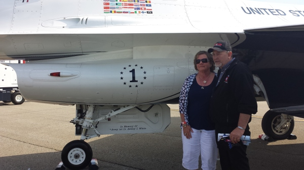 Ashley's Mom and Dad stand beside the tribute to their daughter on an Air Force Thunderbird